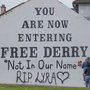 Strong message: The landmark Free Derry Corner has been altered in protest at Lyra McKee's death. Photo: PA