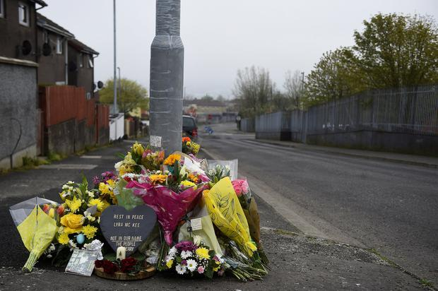 Mark of respect: Flowers and a candle are left at the spot where 29-year-old journalist Lyra McKee was shot dead. Photo: Reuters