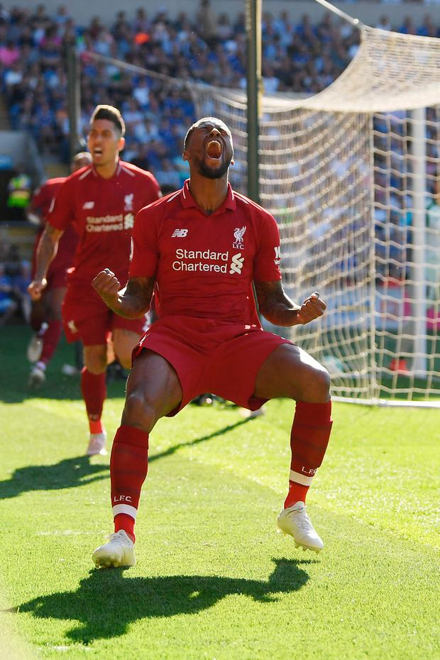 Georginio Wijnaldum celebrates after giving Liverpool the lead against Cardiff City yesterday. Photo: Mike Hewitt/Getty Images