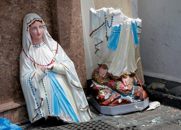 Broken: A smashed statue of the Virgin Mary from the St Anthony's Shrine in Colombo. Picture: Reuters