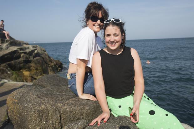 Cassie Smith and Kate Walsh from Celbridge enjoy the sun at the Forty Foot. Photo: Tony Gavin 21/4/2019