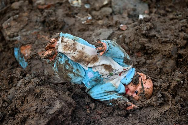 A doll is seen in the mud after a landslide in Rosas, Valle del Cauca department, in southwestern Colombia, on April 21, 2019. (Photo by LUIS ROBAYO / AFP)LUIS ROBAYO/AFP/Getty Images