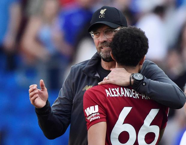 Liverpool manager Juergen Klopp celebrates after the match with Trent Alexander-Arnold. REUTERS/Rebecca Naden