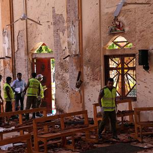 Police officers work at the scene at St. Sebastian Catholic Church, after bomb blasts ripped through churches and luxury hotels on Easter, in Negambo, Sri Lanka April 22, 2019. REUTERS/Athit Perawongmetha