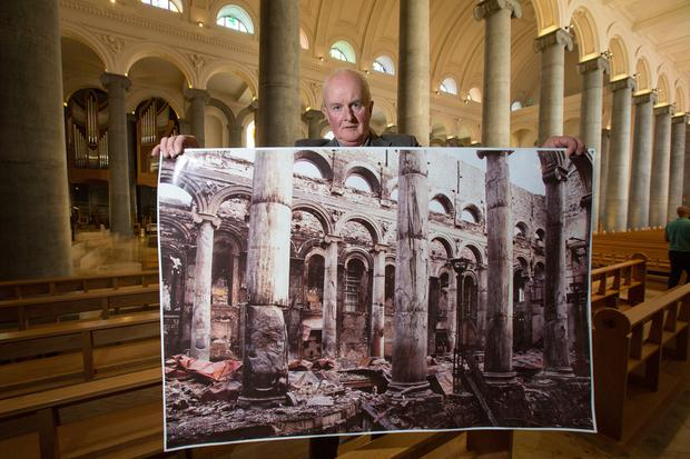 Tiernan Dolan in St Mel's Cathedral with one of his photos. Picture: Mark Condren