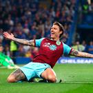 Jeff Hendrick celebrates after scoring Burnley's opening goal against Chelsea at Stamford Bridge. Photo: Clive Rose/Getty Images
