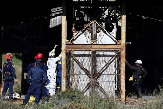 Cypriot special Rescue Forces loaded a special camera inside a flooded mineshaft where two female bodies were found, outside of Mitsero village near capital Nicosia, Cyprus. (AP Photo/Petros Karadjias)