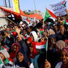 Protesters holding national flags shout slogans during a demonstration in front of the Defence Ministry in Khartoum, Sudan April 22, 2019. REUTERS/Umit Bektas