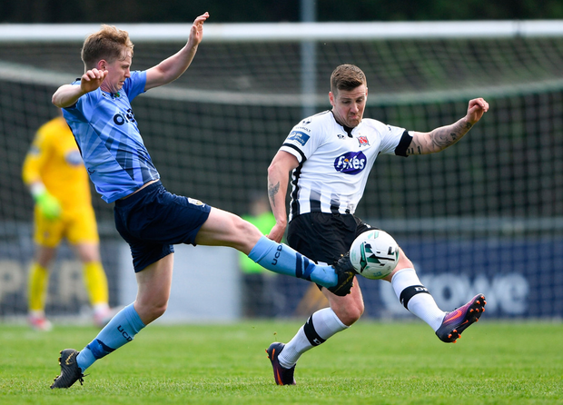 Patrick McEleney of Dundalk in action against Timmy Molloy of UCD. Photo: Harry Murphy/Sportsfile