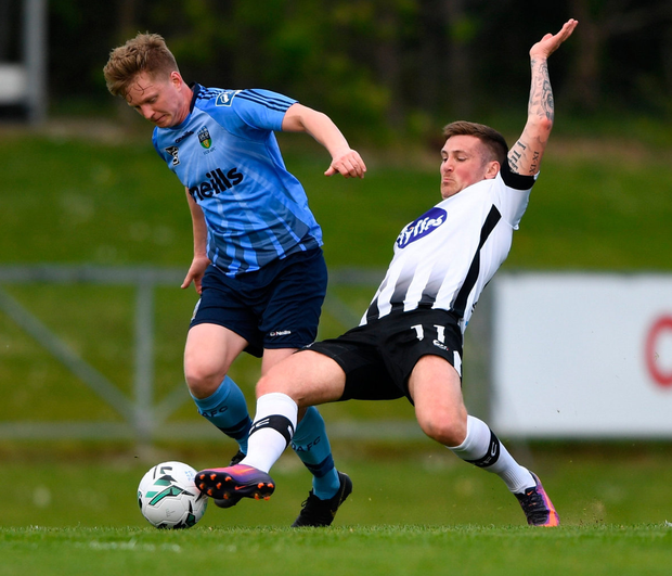 Sean McDonald of UCD in action against Patrick McEleney of Dundalk. Photo: Harry Murphy/Sportsfile