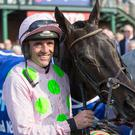 Ruby Walsh celebrates with Burrows Saint after winning the Irish Grand National at Fairyhouse