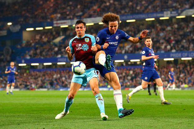 Jack Cork of Burnley and David Luiz of Chelsea battle for possession during the Premier League match between Chelsea FC and Burnley FC at Stamford Bridge on April 22, 2019 in London, United Kingdom. (Photo by Warren Little/Getty Images)