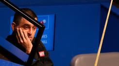 Ronnie O'Sullivan appears dejected during day four of the 2019 Betfred World Championship at The Crucible, Sheffield. Nigel French/PA Wire
