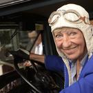 Heidi Hetzer poses in a Hudson Great Eight Oldtimer (1930) in Berlin, Germany (Britta Pedersen/AP)