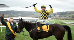 Paul Townend celebrates on Al Boum Photo after winning the Magners Cheltenham Gold Cup Chase on Day Four of the Cheltenham Racing Festival at Prestbury Park in Cheltenham, England. Photo by David Fitzgerald/Sportsfile