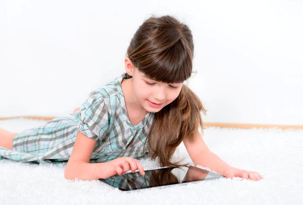 Let them play on the iPad for an hour, it won't kill them, and you can keep an eye out for social services over your sneaky glass of wine. Stock image