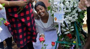 Grief: A relative weeps over the grave of a victim of the Easter bombings in Colombo, Sri Lanka. Image: AP/Eranga Jayawardena