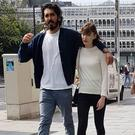 Dev Patel and Tilda Cobham Hervey spotted arm-in-arm on St Stephen's Green, Dublin