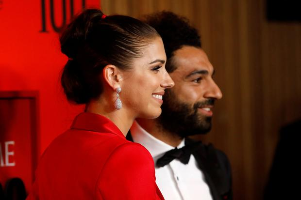 U.S. soccer player Alex Morgan poses with Liverpool's Mohamed Salah as they arrive for the Time 100 Gala celebrating Time magazine's 100 most influential people in the world in New York, U.S., April 23, 2019. REUTERS/Andrew Kelly