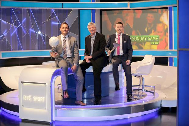 Michael Lyster (centre) with Donal Óg Cusack (right) and Eamonn O'Hara on The Sunday Game in 2013