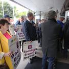 Farmers enter into the AIB AGM, as the IFA stage a protest at Allied Irish Bank's AGM which was taking place in the Ballsbridge Hotel. Picture: Finbarr O'Rourke