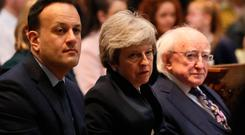 Taoiseach Leo Varadkar, British Prime Mnister Theresa May and President Michael D Higgins before the funeral service for murdered journalist Lyra McKee at St Anne's Cathedral in Belfast Brian Lawless/PA Wire