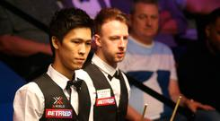Thepchaiya Un-Nooh (left) and Judd Trump during day five of the 2019 Betfred World Championship at The Crucible, Sheffield. Nigel French/PA Wire