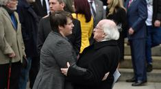 President Michael D. Higgins comforts Lyra McKee's partner Sara Canning after the murdered journalist's coffin at St Anne's Cathedral in Belfast Charles McQuillan/Pool via REUTERS