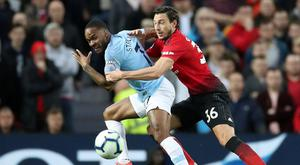 Soccer Football - Premier League - Manchester United v Manchester City - Old Trafford, Manchester, Britain - April 24, 2019 Manchester City's Raheem Sterling in action with Manchester United's Matteo Darmian. Action Images via Reuters/Carl Recine