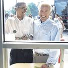 Connection: Barack Obama and Joe Biden laugh as they order ice cream at the Windmill Ice Cream Shop in Aliquippa, Pennsylvania, during the campaign for their 2008 White House run. Photo: Alex Brandon/AP