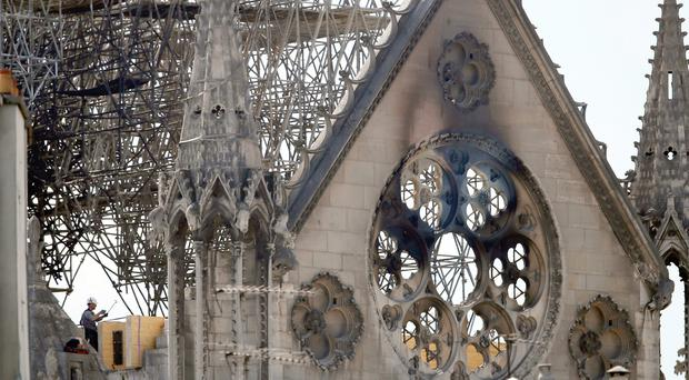 Notre-Dame workers on roof admit they flouted smoking ban