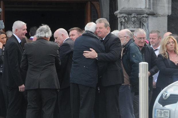 Funeral Mass: Mourners for Carmel Collins meet her grieving husband Steve at the funeral at St John's Cathedral, Limerick, yesterday