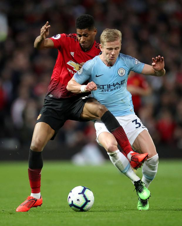 Manchester City's Oleksandr Zinchenko battles with Manchester United's Marcus Rashford. Photo: Reuters/Carl Recine