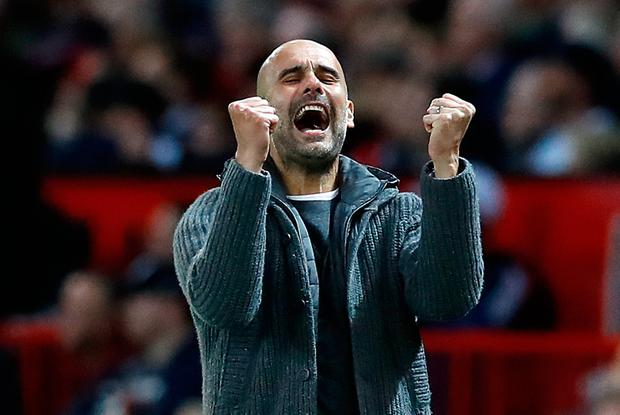Manchester City manager Pep Guardiola celebrates his side's second goal during the Premier League match at Old Trafford, Manchester. Photo credit: Martin Rickett/PA Wire.