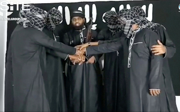 A group of men purported to be the Sri Lanka bomb attackers is seen at an unknown location in this still image taken from video uploaded by Isil's AMAQ news agency and received by Reuters via SITE Intel Group.