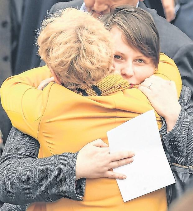 Comfort: Lyra McKee's partner Sara Canning receives a warm hug yesterday. Photo: Gerry Mooney
