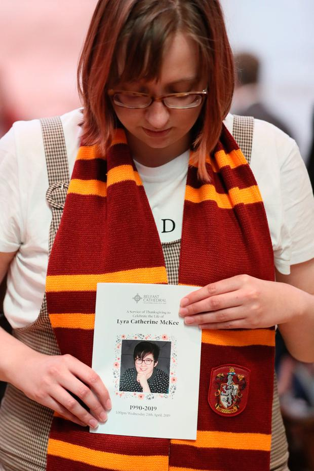 Mourning: A mourner wearing a Gryffindor scarf at the funeral service of Lyra McKee. Photo: BRIAN LAWLESS/AFP/Getty Images