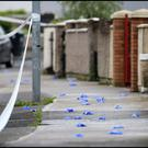 Surgical gloves cover the blood spattered street close to the scene of the shooting at Cushlawn Park in Killinarden Tallaght.