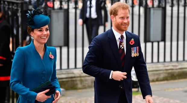 Britain's Catherine, Duchess of Cambridge, (L) and Britain's Prince Harry, Duke of Sussex, (R) arrive to attend a service of commemoration and thanksgiving to mark Anzac Day in Westminster Abbey in London on April 25, 2019