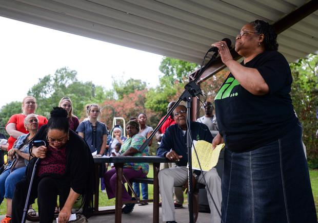 Betty Boatner, a sister of James Byrd Jr., talks to the crowd during a prayer vigil at James Byrd Memorial Park in Jasper, Texas on Wednesday (Ryan Welch/The Beaumont Enterprise via AP)