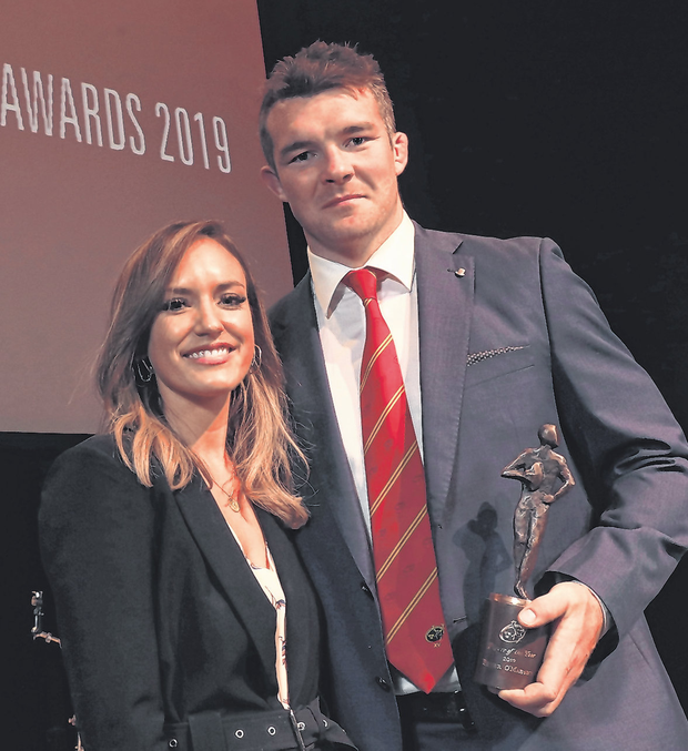 Peter O'Mahony receives the Player of the Year award alongside his fiancee Jessica at the Munster Rugby Awards.