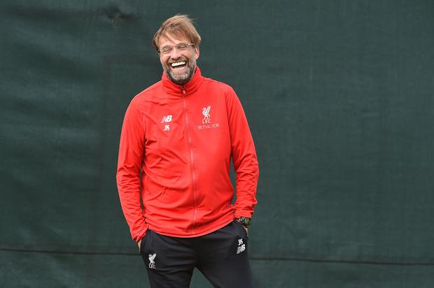 Jurgen Klopp is all smiles at training yesterday ahead of tonight's Premier League clash against Huddersfield