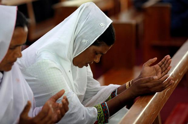 Mass: Women pray for the victims of the blasts. Photo: Reuters