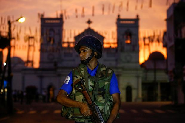 A security officer stands guard outside St. Antony's Shrine, days after a string of suicide bomb attacks on churches and luxury hotels across the island on Easter Sunday, in Colombo, Sri Lanka April 26, 2019. REUTERS/Thomas Peter
