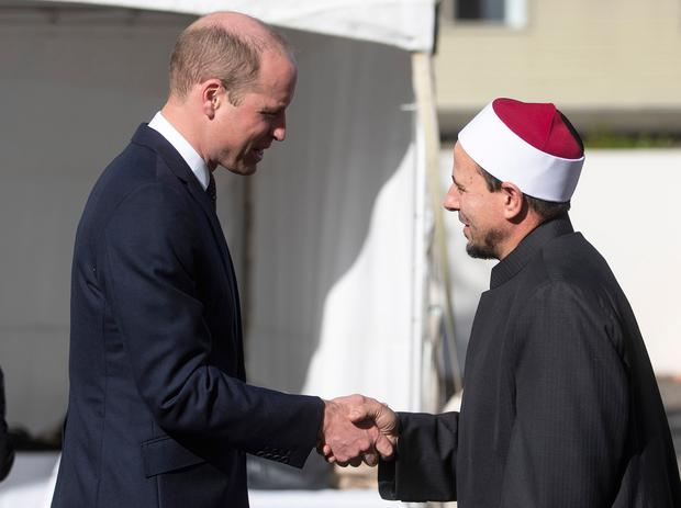 Britain's Prince William, left, meets Imam Gamal Fouda of Masjid Al Noor at the Al Noor mosque during a visit to the mosque in Christchurch (Joseph Johnson/Pool Photo via AP)