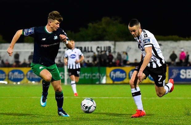 Dundalk's Michael Duffy in action against Ronan Finn of Shamrock Rovers. Photo: Seb Daly/Sportsfile
