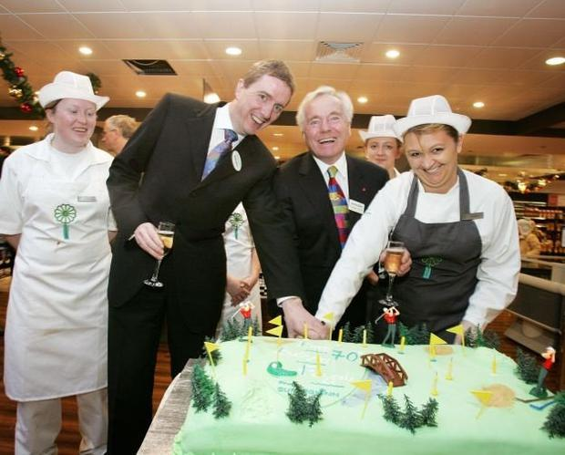 Service with a smile: Feargal Quinn and members of staff, enjoying his 70th birthday celebration