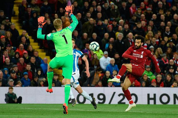 Mo Salah scores Liverpool's third goal against Huddersfield. Photo: OLI SCARFF/AFP/Getty Images