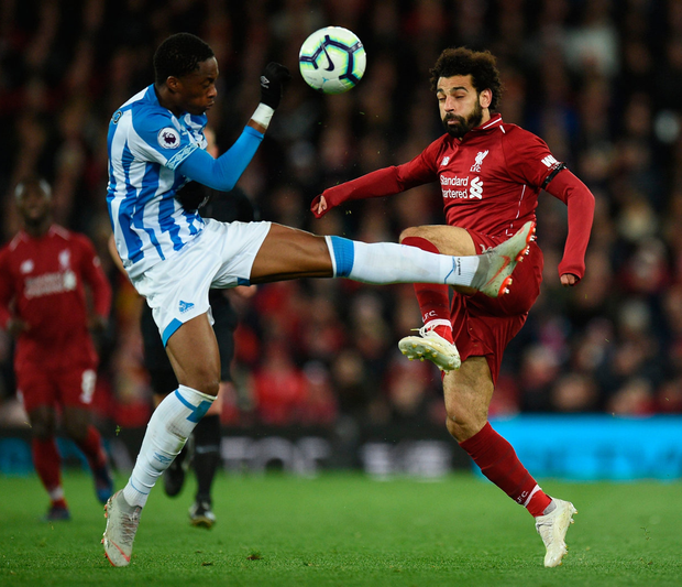Huddersfield's Terence Kongolo (left) vies with Liverpool's Mo Salah. Photo: OLI SCARFF/AFP/Getty Images