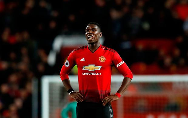 Staying in red?: Ole Gunnar Solskjaer is confident that Paul Pogba will remain at Old Trafford
